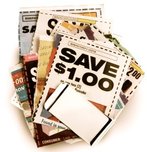 Savings coupons held together by silver money clip